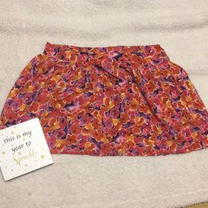 Bright orange and red floral mini skirt